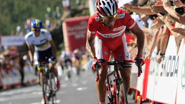"Katusha Team rider and leader of the race Joaquim ""Purito"" Rodriguez of Spain (R) and Team Saxo Bank rider Alberto Contador of Spain cycle during the 12th stage of the Tour of Spain ""La Vuelta"" cycling race, August 30 2012 (Reuters)"