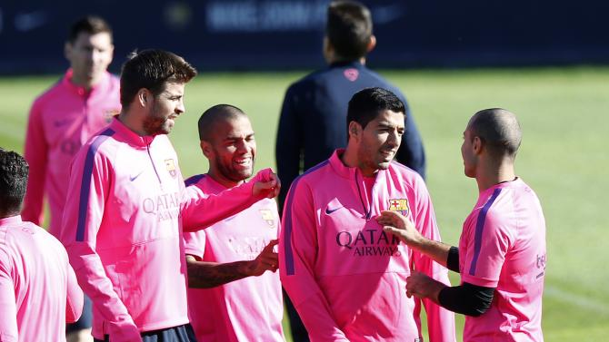 Barcelona's Gerard Pique, Dani Alves nd Mascherano jokes with teammate Luis Suarez before training session at Ciutat Esportiva Joan Gamper in Sant Joan Despi