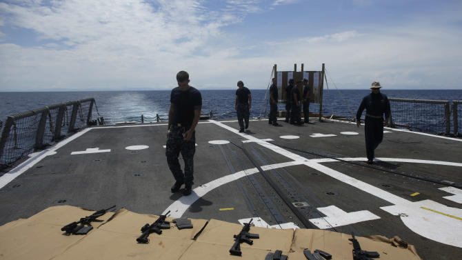 ADVANCED FOR USE SUNDAY FEB. 3 AND THEREAFTER In this Oct. 12, 2012 photo, sailors participate in M4 rifle small arms qualification on the flight deck onboard the USS Underwood while patrolling in international waters near Panama.  In the most expensive initiative in Latin America since the Cold War, the U.S. has militarized the battle against drug traffickers, spending more than $20 billion in the past decade. U.S. Army troops, Air Force pilots and Navy ships outfitted with Coast Guard counternarcotics teams are routinely deployed to chase, track and capture drug smugglers. (AP Photo/Dario Lopez-Mills)