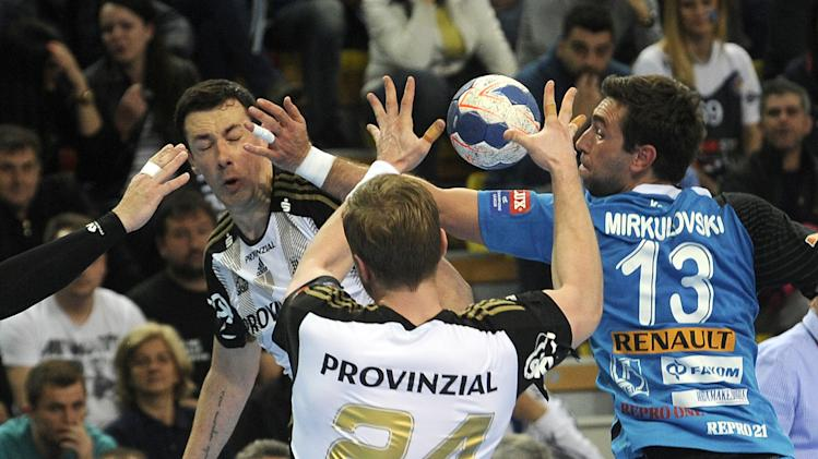 THW Kiel's Marko Vujin, left, passes the ball to his teammate Aron Palmarsson, center, beside Metalurg's Filip Mirkulovski, right, during their men's EHF Champions League handball match in Skopje, Macedonia, Saturday April 19, 2014. (AP Photo/Boris Grdanoski)