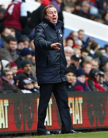 Queens Park Rangers' manager Redknapp instructs his team during their English Premier League soccer match against Aston Villa in Birmingham