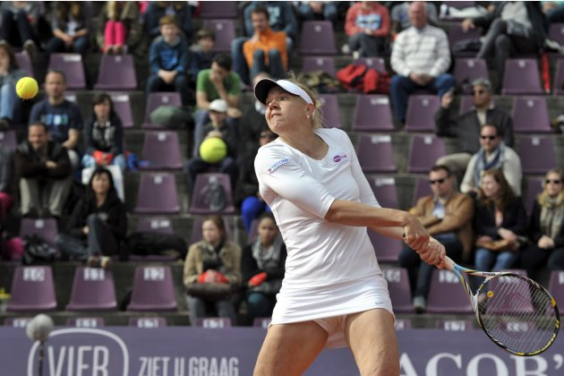 Kanepi hits a return to Peng in their final match of the WTA Brussels Open tennis tournament