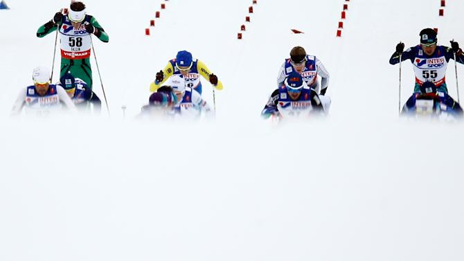 Athletes start the men's cross country 50 km mass start classic race at the Nordic World Ski Championships in Falun
