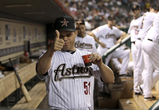 Houston Astros pitcher Wandy Rodriguez gives a thumbs-up in the dugout moments after finding out that he had been traded to the Pittsburgh Pirates, during the fifth inning of a baseball game Tuesday, July 24, 2012, in Houston. (AP Photo/Houston Chronicle, Karen Warren) MANDATORY CREDIT