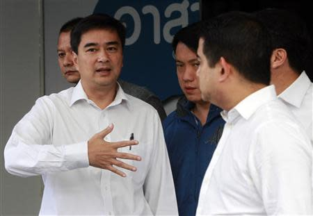 Thailand's opposition leader and former Prime Minister Abhisit Vejjajiva speaks with his party members before a news conference at the Democrat Party headquarters in Bangkok