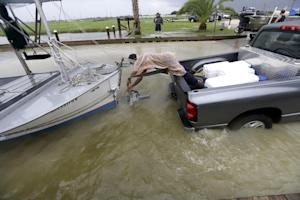 C.J. Johnson pulls a shrimp boat out of the water in…