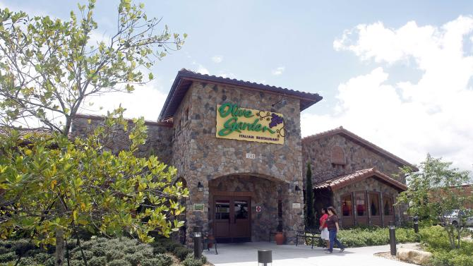 An Olive Garden restaurant is shown in Hialeah, Fla., Thursday, Sept. 6, 2012. Servers at Olive Garden, Red Lobster and other eateries are suing the restaurants' parent company, claiming they were cheated out of overtime pay and not allowed to clock-in until customers arrived. The federal lawsuit against Darden Restaurants seeks back pay and other compensation, plus interest and attorney's fees. (AP Photo/Alan Diaz)