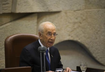 Outgoing Israeli President Peres speaks during the swearing-in ceremony of incoming President Rivlin at the Knesset in Jerusalem