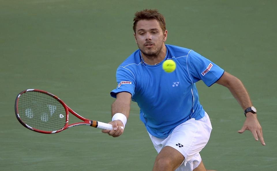 Stanislas Wawrinka of Switzerland returns a shot against Roger Federer of Switzerland during their match at the BNP Paribas Open tennis tournament, Wednesday, March 13, 2013, in Indian Wells, Calif. (AP Photo/Mark J. Terrill)