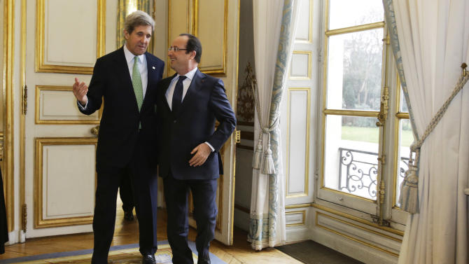 FILE - In this Feb. 27, 2013, file photo, U.S. Secretary of State John Kerry walks with French President Francois Hollande after their meeting at Elysee Palace in Paris. With the smile of a seasoned politician, a flair for languages and a vast repertoire of personal anecdotes, Kerry schmoozed and cajoled his way through Europe and the Middle East on his first trip abroad as America's top envoy over the past 10 days.(AP Photo/Jacquelyn Martin, Pool)