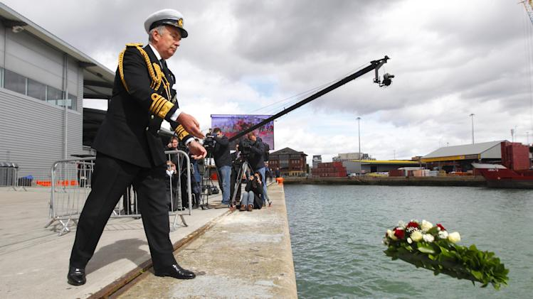 British Royal Navy Admiral Lord West casts a memorial wreath to victims of the Titanic disaster into the dock from where the ill-fated liner sailed 100 years ago today, Southampton, England, Tuesday, April 10, 2012. (AP Photo/Chris Ison) UNITED KINGDOM OUT, NO SALES, NO ARCHIVE