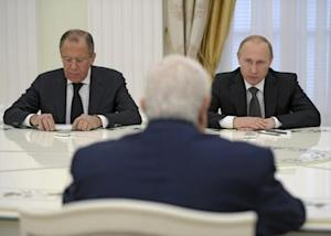 Russian President Putin, Foreign Minister Lavrov and Syrian Foreign Minister Muallem attend a meeting at the Kremlin in Moscow