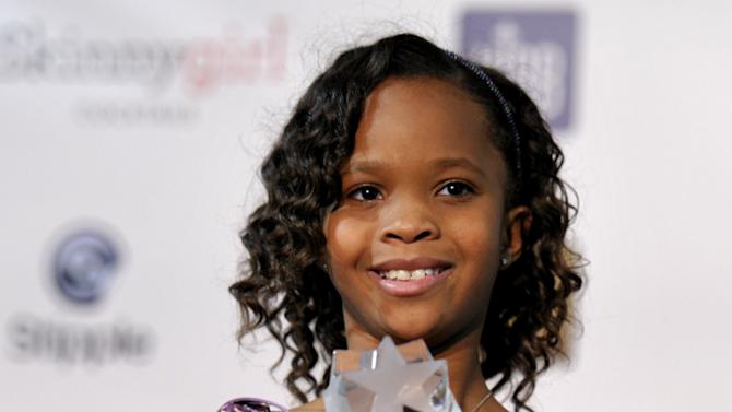 "FILE - In this Jan. 10, 2013 file photo, Quvenzhane Wallis is seen backstage with her award for best young actress for ""Beasts of the Southern Wild,"" at the 18th Annual Critics' Choice Movie Awards at the Barker Hangar in Santa Monica, Calif. Wallis is an actress of talent, poise and maturity well beyond her years. She was 6 when she played the part of Hushpuppy, and at only 9, she is the youngest-ever best actress nominee at the Academy Awards. (Photo by John Shearer/Invision/AP, File)"