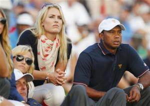 U.S. golfer Woods and girlfriend Vonn sit with teammate Phil Mickelson and Phil's wife Amy as they watch play during the opening Four-ball matches for the 2013 Presidents Cup golf tournament at Muirfield Village Golf Club in Dublin