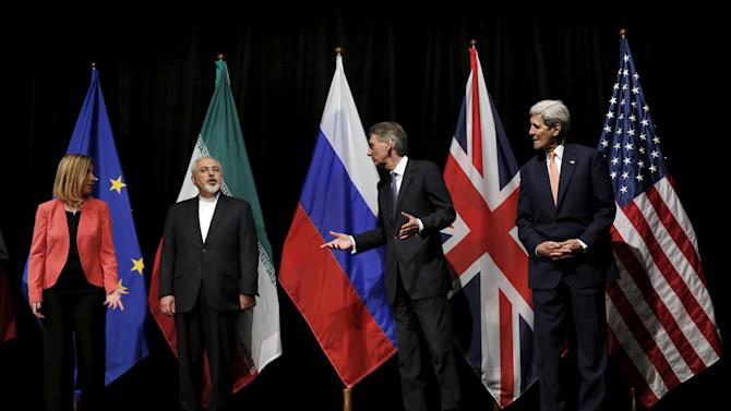 British Foreign Secretary Philip Hammond, U.S. Secretary of State John Kerry and European Union High Representative for Foreign Affairs and Security Policy Federica Mogherini talk to Iranian Foreign Minister Mohammad Javad Zarif in Vienna