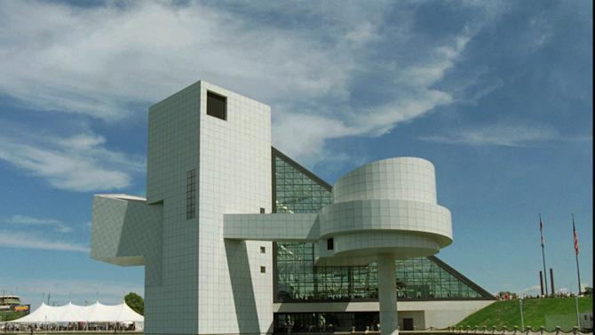 FILE - In this Sept. 2, 1995, file photo, The Rock and Roll Hall of Fame and Museum in Cleveland is visible. The hall is Cleveland's biggest international tourist attraction. (AP Photo/Mark Duncan, File)