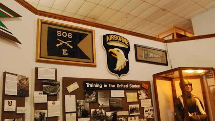 "The flag of Easy Company, 506th Parachute Infantry Regiment, who were made famous as the ""Band of Brothers"" in World War II, is seen on a wall on June 27, 2013, inside the museum at Fort Campbell, Ky. The 101st Airborne Division is trying to save their storied 506th Infantry Regiment from being eliminated under the Army's massive restructuring. (AP Photo/Kristin M. Hall)"
