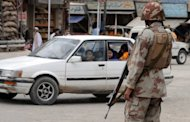 Pakistani soldiers stand guard at a checkpoint in Quetta on June 8. Pakistan police say gunmen on motorcycles have shot dead eight men at a laundry in Quetta
