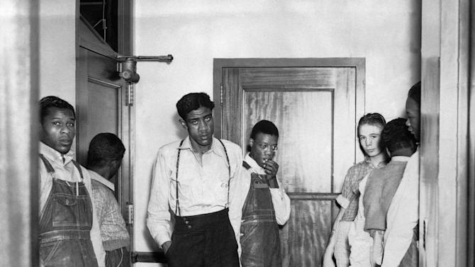 FILE - In this 1937 file photo, the Scottsboro defendants go back to the cells they have occupied for six years in Birmingham, Ala., following arraignment proceedings in Decatur, Ala. (AP Photo)