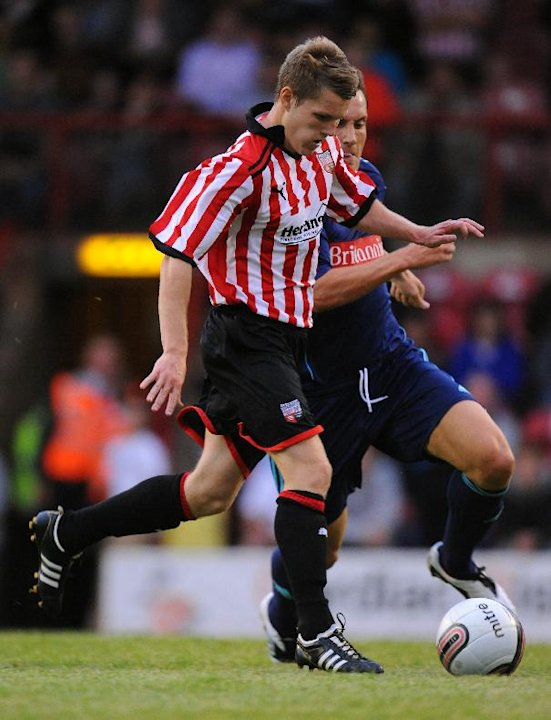 Brentford midfielder Jake Reeves, left, has joined AFC Wimbledon on loan