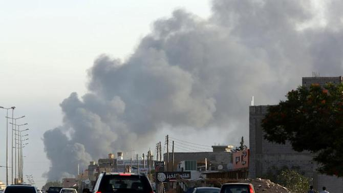 Smoke billows from an area near Tripoli's international airport amid fighting between rival factions on July 24, 2014