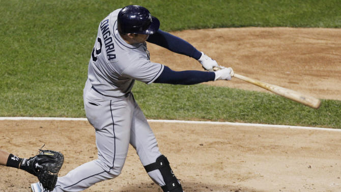 Tampa Bay Rays' Evan Longoria hits a solo home run against the Chicago White Sox during the ninth inning of a baseball game in Chicago, Thursday, Sept. 27, 2012. The Rays won 3-2. (AP Photo/Nam Y. Huh)