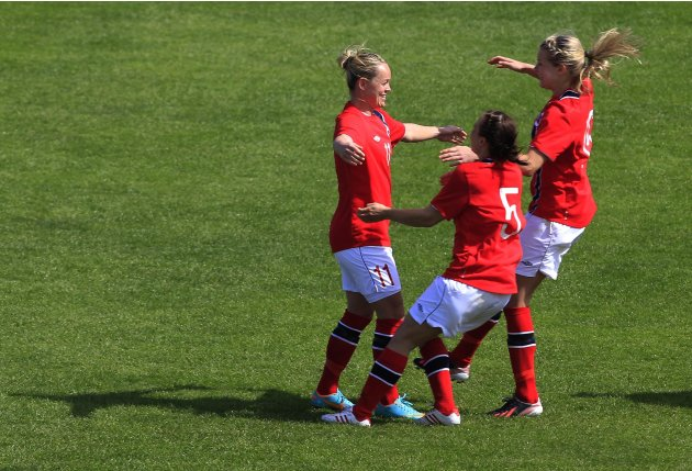 Norway's Leni Larsen Kaurin (L) celebrates her penalty goal against Sweden with team mates Toril Hetland Akerhaugen (5) and  Ada Hegerberg during the third-place women's Algarve Cup socccer match