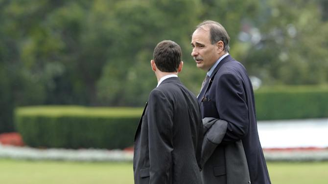 Obama advisers David Plouffe, left, and David Axelrod, right, talk as they walk to Marine One on the South Lawn of the White House in Washington, Wednesday, Sept. 5, 2012. They are traveling with President Barack Obama to Charlotte, N.C., for the Democratic National Convention. (AP Photo/Susan Walsh)