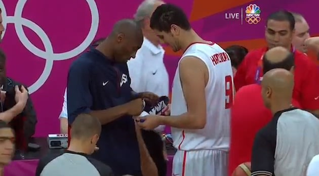 Kobe Bryant signs the shoe of Tunisian forward Mohamed Hdidane — NBC Sports Network screenshot