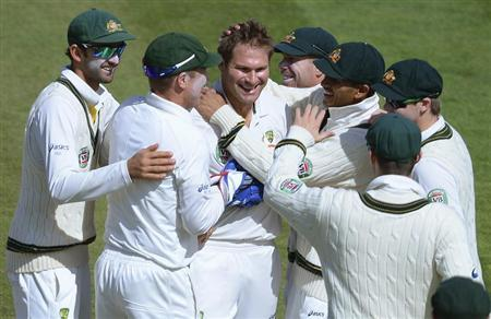 Australia's Harris celebrates with teammates after taking the wicket of England's Matt Prior during their fourth Ashes test cricket match at the Riverside cricket ground, Chester-Le-Street