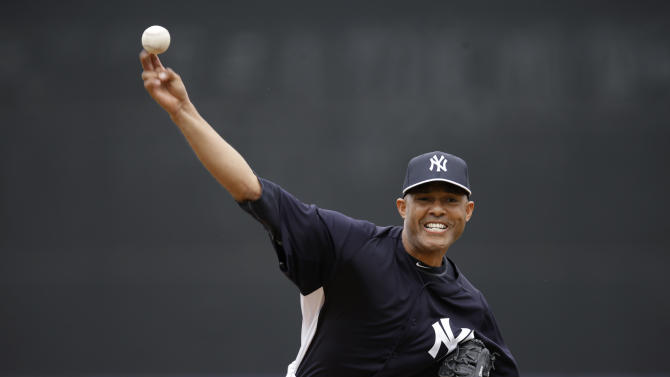 New York Yankees relief pitcher Mariano Rivera, who announced his plans to retire at the end of this season, delivers a warmup pitch before facing the Atlanta Braves in the fourth inning of a spring training baseball game at Steinbrenner Field in Tampa, Fla., Saturday, March 9, 2013.  (AP Photo/Kathy Willens)