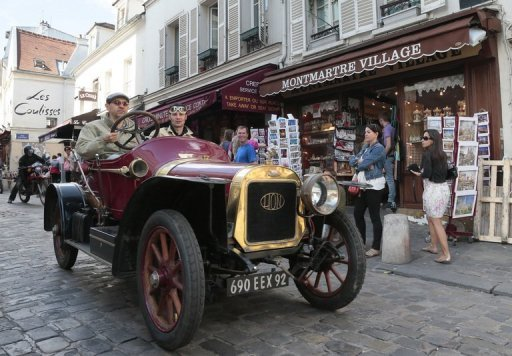 <p>A vintage Peugeot Lion car in the Montmartre district of Paris in July. French auto giant PS Peugeot Citroen must restructure urgently after strategic misjudgements over 20 years, a report for the government warned on Tuesday, urging a tie-up with a global group.</p>