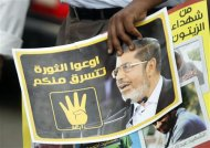"A member of the Muslim Brotherhood and supporter of ousted Egyptian President Mursi holds a poster during a protest named ""People Protect the Revolution"" as they march towards the ""Qasr al-Quba"" presidential palace in Cairo, September 6, 2013. REUTERS/Amr Abdallah Dalsh"