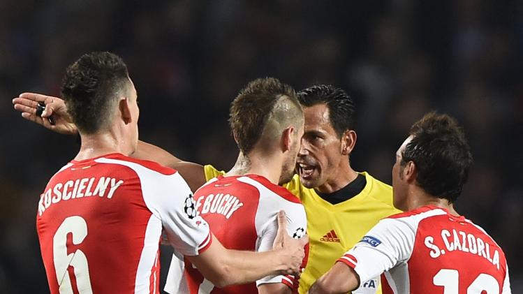 Arsenal's Debuchy is sent off by referee Proenca during their Champions League playoff soccer match against Besiktas at the Emirates stadium in London