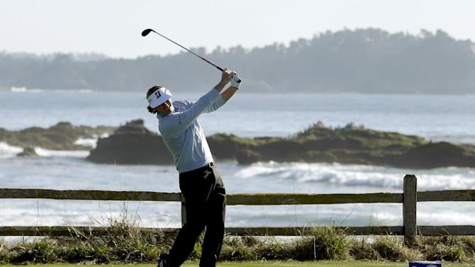Brandt Snedeker hits off the 18th tee of the Pebble Beach Golf Course during the final round of the AT&T Pebble Beach Pro-Am golf tournament Sunday, Feb. 10, 2013, in Pebble Beach, Calif. (AP Photo/Ben Margot)