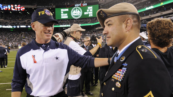 Dallas Cowboys head coach Jason Garrett, left, speaks with Medal of Honor recipient Army Ranger Leroy Petry of New Mexico before an NFL football game between the Dallas Cowboys and the New York Jets Sunday, Sept. 11, 2011,  in East Rutherford, N.J. (AP Photo/Henny Ray Abrams)