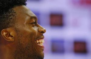 England's Sturridge laughs during a news conference after a training session at the 2014 World Cup in Rio de Janeiro