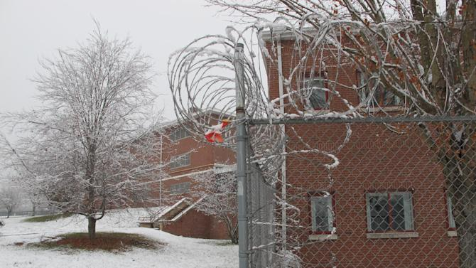 Razor wire surrounds the former Bergin Correctional Institution in Mansfield, Conn., Wednesday, Nov. 27, 2012. A year after the last inmate left the prison, the University of Connecticut is in talks with the state to lease the building as it seeks out more space for offices and laboratories. (AP Photo/Pat Eaton-Robb)