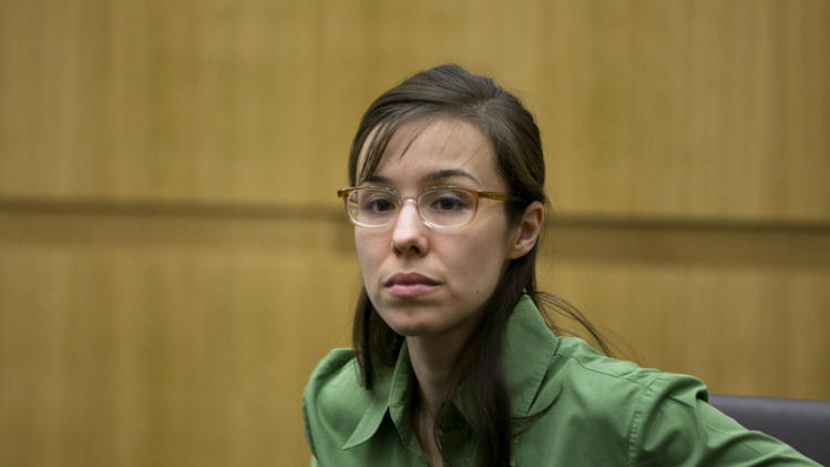 Defendant Jodi Arias looks at the jury as they enter the courtroom during her trial at Maricopa County Superior Court in Phoenix on Wednesday, April 17, 2013.   Arias is on trial for the killing of her boyfriend, Travis Alexander in 2008.  Arias claims self-defense but faces a potential death sentence if convicted of first-degree murder.  (AP Photo/The Arizona Republic, David Wallace, Pool)