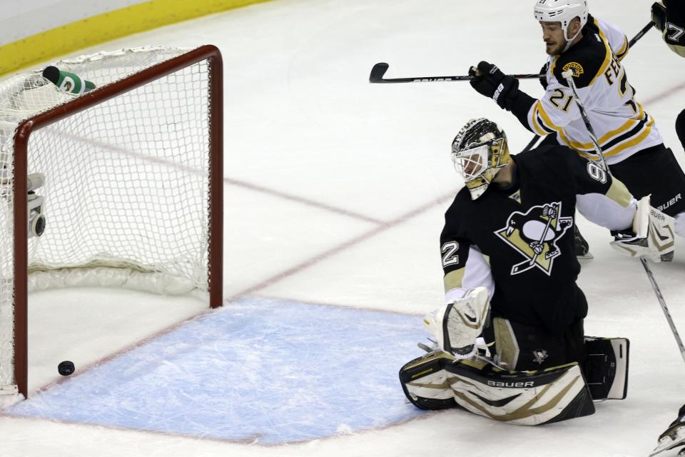 Pittsburgh Penguins goalie Tomas Vokoun (92) watches as a shot by Boston Bruins' David Krejci  gets past him for a goal in the first period of Game 1 in an NHL hockey Stanley Cup Eastern Conference finals, Saturday, June 1, 2013, in Pittsburgh. (AP Photo/Gene J. Puskar)