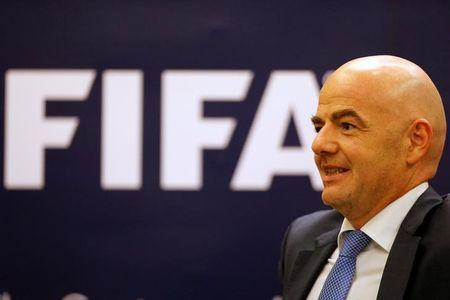 Soccer-Infantino brings vision of new FIFA to Asia