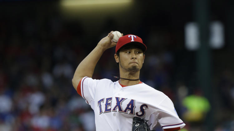Texas Rangers starting pitcher Yu Darvish, of Japan, throws during the first inning of a baseball game against the Los Angeles Angels, Sunday, April 7, 2013, in Arlington, Texas. (AP Photo/LM Otero)