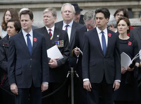 Britain's opposition Labour Party leader Ed Miliband and his wife Justine stand next to Deputy Prime Minister Nick Clegg at the ceremony to mark the 100th anniversary of the start of the Gallipoli campaign, at the Cenotaph on Whitehall in London