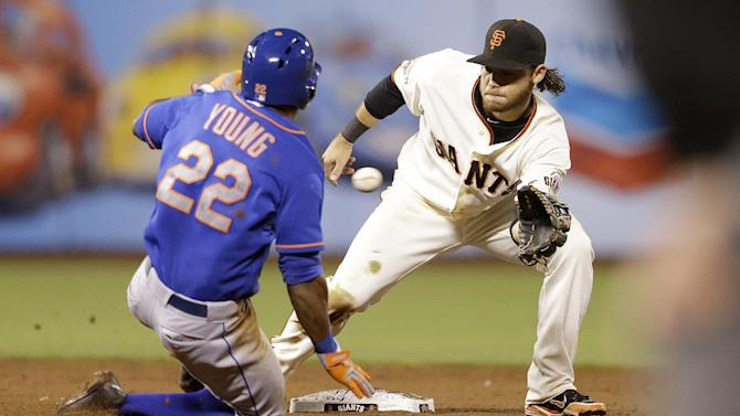 New York Mets' Eric Young Jr. (22) steals second base in front of San Francisco Giants shortstop Brandon Crawford during the sixteenth inning of a baseball game in San Francisco, Tuesday, July 9, 2013. The New York Mets and San Francisco Giants are tied 3-3 after 15 innings. (AP Photo/Jeff Chiu)