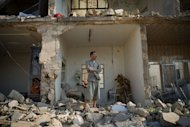 Yousef Hayeni stands in front of the remains of his house following an air strike in the Syrian town of Aazaz, near the northern restive city of Aleppo. UN investigators said Wednesday the Syrian regime has committed crimes against humanity, including the Houla massacre, as two dozen people were reported killed in a devastating air strike in the north