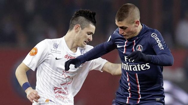 Paris St-Germain's Marco Verratti (R) challenges Montpellier's Remy Cabella (Reuters)
