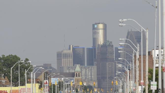The Detroit skyline is seen from Grand River on Thursday, July 18, 2013, in Detroit. On Thursday the city became the largest city in U.S. history to file for bankruptcy when State-appointed emergency manager Kevyn Orr asked a federal judge for municipal bankruptcy protection. (AP Photo/Carlos Osorio)