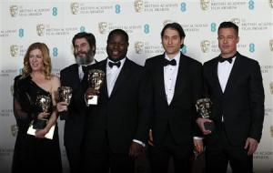 "Director McQueen celebrates with Gardner, Katagas, Kleiner and Pitt after winning Best Film for ""12 Years a Slave"" at the BAFTA awards ceremony in London"
