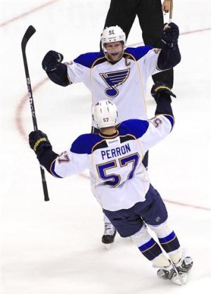 Elliott makes 20 saves for 8th shutout for Blues