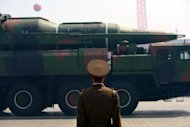 A military vehicle carries what was believed to be a Taepodong-class missile, during a military parade in Pyongyang, in April. North Korea may have put fake versions of a new missile on display at the parade, according to UN sanctions experts